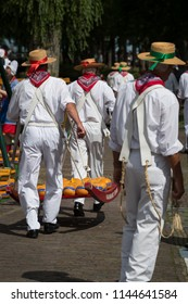 Edam, Netherlands August 2017: Cheese carrier at the traditional Edam cheese market take cheese to be weighed and recorded