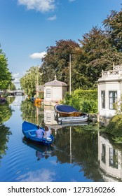 EDAM, NETHERLANDS - AUGUST 25, 2017: Tourists taking a sightseeing tour in a boat in Edam, Netherlands