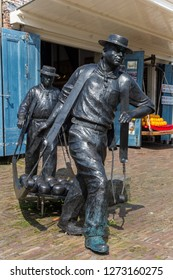 EDAM, NETHERLANDS - AUGUST 25, 2017: Statue of cheese carriers at the cheese market in Edam, Holland
