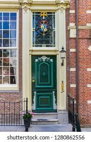 EDAM, NETHERLANDS - AUGUST 25, 2017: Green door of a historic house in Edam, Holland