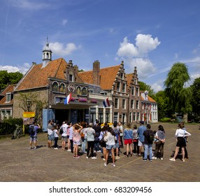 Edam, Netherlands, July 2017. Group of tourists with their guide in front of the cheese weighing house of Edam