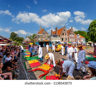 Edam, Netherlands, July 2018. Tourists watching the trading in Edam cheese near the cheese weighing house on a beautiful summer day