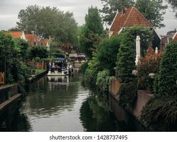 Edam, The Netherlands - June 3, 2019: canal scene in Edam, The Netherlands (Holland), Europe