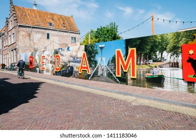 Edam, Netherlands - May 14, 2019: colored inscription on the wall in the city of Edam
