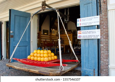 Edam, The Netherlands - may 22 2017:  A cheese berrie placed in front of the old cheese weigh house of Edam