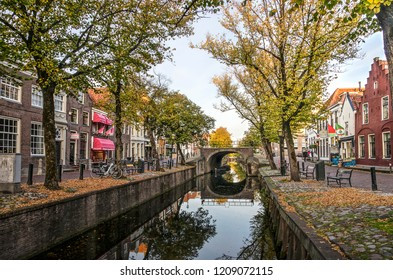 Edam, The Netherlands, October 7, 2018: view along Voorhaven canal towards Dam square in late afternoon in autumn