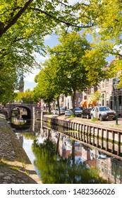 EDAM, NETHERLANDS - SEPTEMBER 1, 2018:  Street scene with canal and bridge seen from Edam Netherlands