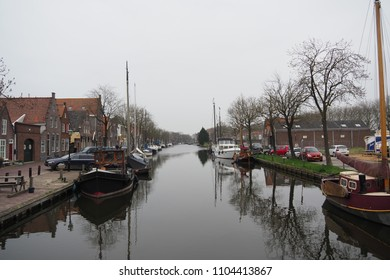 Edam, North Holland / Netherlands - April 14th 2018: Canal View With Boats In Edam, Netherlands