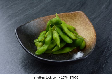 Edamame, or edamame bean in black plate on black marble table
