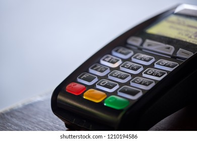 EDC machine or credit card terminal on wooden table for making payment in retail store. Concept of cashless economy. Close up image with copy space and selective focus point.