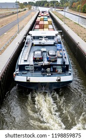 EDDERSHEIM, GERMANY - September 22, 2018: inland container vessel MILANO in the Main River lock of Eddersheim sluice west of Frankfurt
