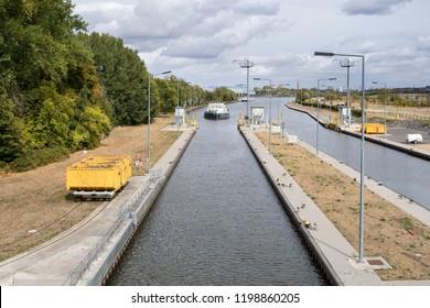 EDDERSHEIM, GERMANY - September 22, 2018: inland general cargo vessel AQUADRAAT entering the Main River lock of Eddersheim sluice west of Frankfurt