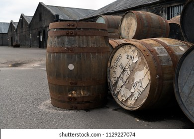 Edderton, Scotland - June 08,2018: Empty wooden casks on the warehouse yard prepared for scotch whisky at a distillery