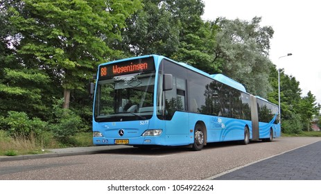 Ede / Netherlands - August 12 2013: A Syntus Mercedes Benz Citaro G (Gelede) Bus by the station of the dutch city Ede. The bus have the blue livery of the Valleilijn and Veluwelijn
