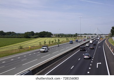 EDE, THE NETHERLANDS - JUNE 6, 2016. Highway A12 from Arnhem to Utrecht on a sunny summer day. Dutch highways are notoriously busy as logistics are a key part of the country's economy.