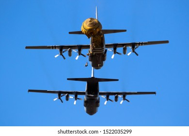 EDE, NETHERLANDS - SEP 21, 2019: Group of military parachutist paratroopers jumping out of a transport plane during the Operation Market Garden memorial.