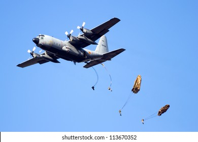 EDE, NETHERLANDS - SEP 22: Belgian C-130 Hercules drops para troopers at the Operation Market Garden memorial on Sep 22, 2012 near Ede, Netherlands. Market Garden was a large Allied operation in 1944