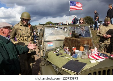 EDE, NETHERLANDS - SEP 22: US Army material and visitors during the Market Garden memorial on Sep 22, 2012 near Ede, Netherlands. Market Garden was a large Allied military operation in September 1944