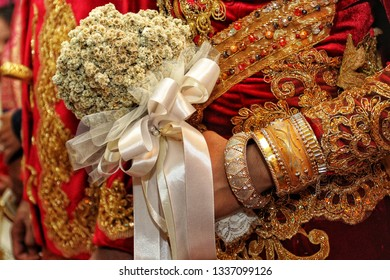 Edelweiss flower bouquet at the wedding and traditional Minang ornaments