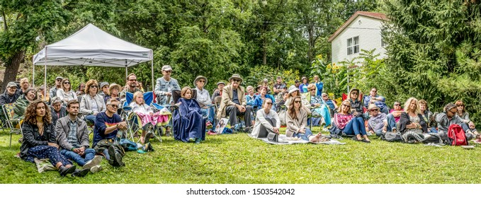 EDEN MILLS, ONTARIO, CANADA - SEPTEMBER 8, 2019: Spectators listen as authors read from their books at the annual Eden Mills Writers Festival.