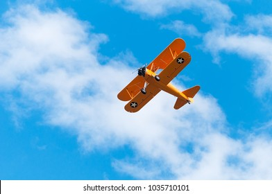 EDEN PRAIRIE, MN - JULY 16 2016: N2S-1 Bush Stearman flies overhead. A trainer aircraft during WWII, this plane was one of several flown by former president George H W Bush during his flight training.