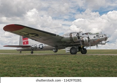 EDEN PRAIRIE, MN - JULY 16 2016: B-17G bomber Yankee Lady engines running prior to takeoff at air show. This B-17 was a Flying Fortress built for use during WW II but never flew in any combat missions
