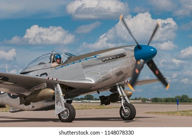 """EDEN PRAIRIE, MN - JULY 16, 2016: P-51 Mustang """"Sierra Sue II"""" turns on taxiway at air show. The P-51 Mustang was a long-range, single-seat fighter used primarily during World War II."""