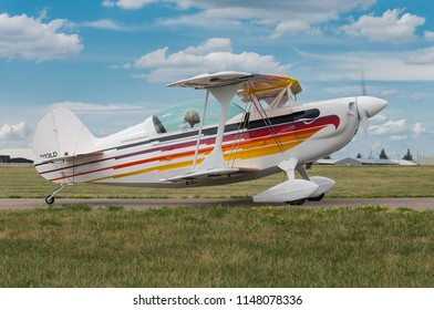 EDEN PRAIRIE, MN - JULY 16, 2016: Christian Eagle II piloted by Denny O'Connell on taxiway at air show. The Christian Eagle II is an aerobatic sporting biplane produced in the US since the late 1970s.