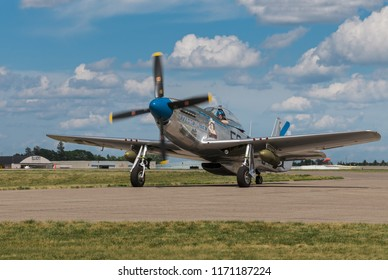 EDEN PRAIRIE, MN - JULY 16, 2016: P-51 Mustang Sierra Sue II taxis in at air show. The P-51 Mustang was a long-range, single-seat fighter used primarily during World War II.