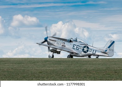 EDEN PRAIRIE, MN - JULY 16, 2016: P-51 Mustang Sierra Sue II taxis out at air show. The P-51 Mustang was a long-range, single-seat fighter used primarily during World War II.