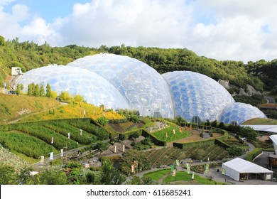 Eden Project, Cornwall, England – August 24, 2010: The world's largest rainforest in captivity with steamy jungles and waterfalls. Educational centre and demonstrations to inspire all ages.