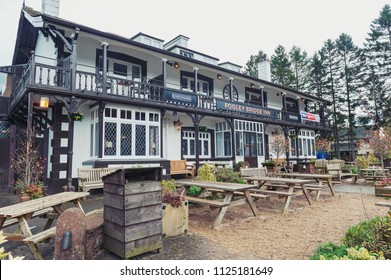 Eden, UK - April 2018: Front facade of Pooley Bridge Inn, a local accommodation located in the center of Pooley Bridge village near Ullswater, famous English lake in the Lake District of England