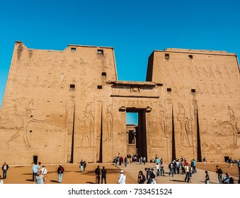 Edfu, Aswan, Egypt - 2008 ( Entrance of the Edfu temple in Aswan with tourists in the fore ground )