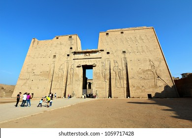 EDFU, EGYPT - 28 DECEMBER 2017: Tourists visit the ancient ruins of Edfu Temple. Egyptian tourism has dropped from 25 million visitors in 2010 to 5 million in 2017 following the Arab Spring. Editorial