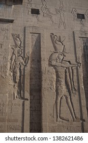 Edfu, Egypt: Detail of carvings on the first pylon of the temple of Edfu, the largest temple dedicated to Horus and Hathor of Dendera.