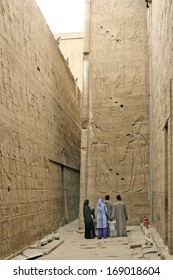 EDFU, EGYPT - JANUARY 12: Tourists admire the reliefs of the Edfu Temple that dedicated to the falcon god Horus on January 12, 2006 in Edfu, Egypt. UNESCO World Heritage Site