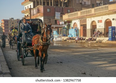 Edfu / Egypt - March 13, 2019: Horse cab drivers line up to take visitors to the temple of Edfu, the largest temple dedicated to Horus and Hathor of Dendera.