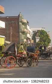 Edfu / Egypt - March 13, 2019: Horse cab traffic on the streets of Edfu. Drivers take tourists to the temple of Edfu, the largest temple dedicated to Horus.