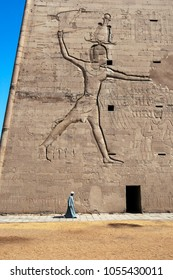 EDFU, EGYPT - MARCH 17, 2010 : The pylon at the Temple of Horus at Edfu in Egypt. Standing 36 metres high, the pylons walls are engraved with reliefs depicting Ptolemy XII Neos Dionysos and Horus.