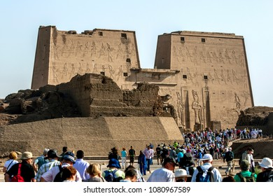 EDFU, EGYPT - MARCH 17, 2010 : Tourists flock towards the Temple of Horus in Edfu in Egypt. Building of the temple was begun by Ptolemy lll in 237BC.