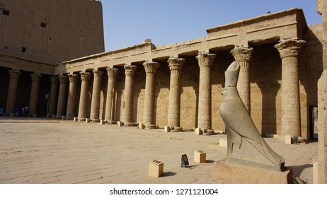 EDFU, EGYPT - OCTOBER 1, 2018: The Temple of Horus (also known as the Temple of Edfu). Inside the Court of Offerings - granite statue of Horus at the Hypostyle Hall