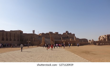 EDFU, EGYPT - OCTOBER 12, 2018: Tourists flock towards the Temple of Horus in Edfu in Egypt. Building of the temple was begun by Ptolemy lll in 237BC.