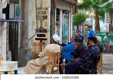 Edfu, nile river / Egypt - 04 15 2015: To look at football and smoke water pipe at every cafeteria during football cups is very popular activity.