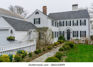 Edgartown, Massachusetts, USA - April 20th, 2019: Typical Cape Cod federal architecture that can be found around Martha's Vineyard, with blank or grey houses, covered with clapboards