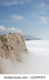 Edge of the cliff above the clouds