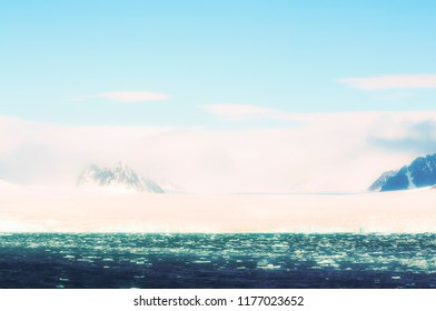 Edge of Ice Pack in the Arctic Ocean with Foggy Mountains in the Background off the Coast of Norway