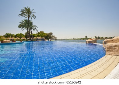The Edge Of An Infinity Swimming Pool At A Tropical Hotel On The Edge Of A