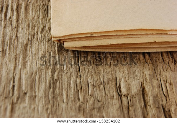 edge of the old newspaper on a wooden background