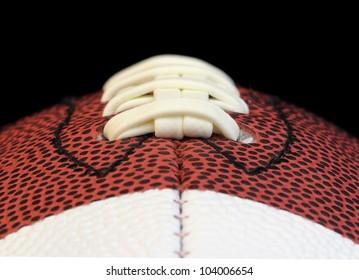 Edge on macro of a football threads isolated on black