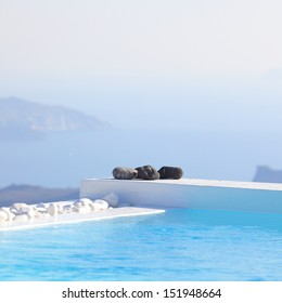 Edge of a pool on the cliff of Santorini, Greece